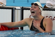 Stephanie in the pool after a race with a delighted look on her face after realizing she reached the podium