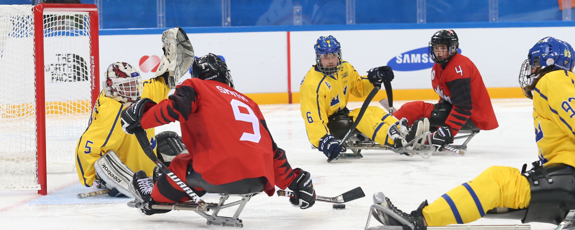 Corbyn Smith on team Canada playing offence against the Swiss