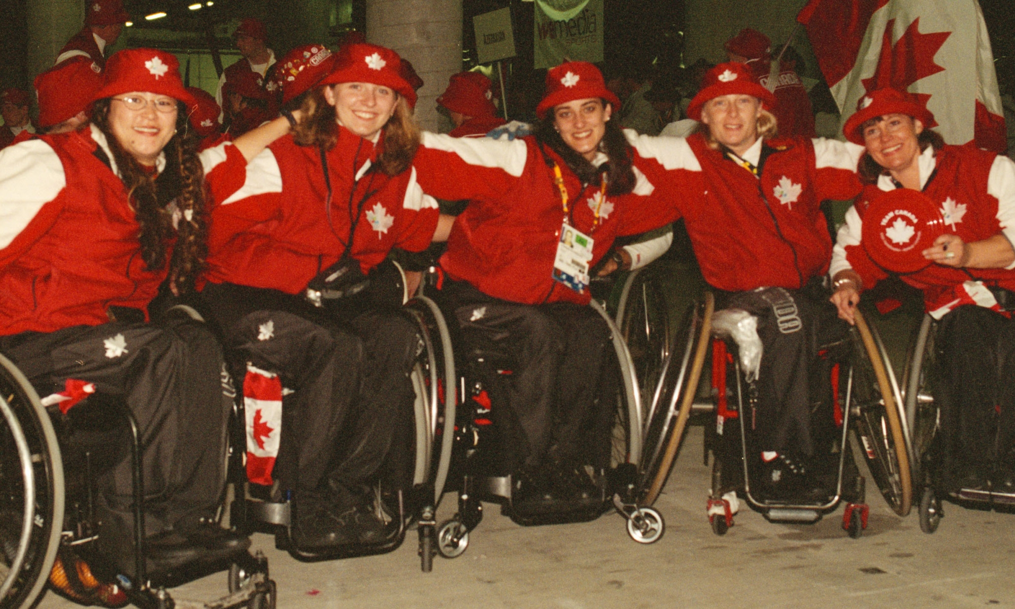 Athletes in wheelchairs and Canada gear from the Sydney 2000 Paralympic Games