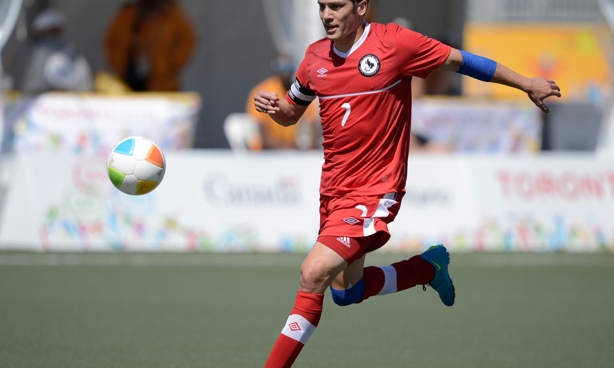 Athlete kicking a soccer ball