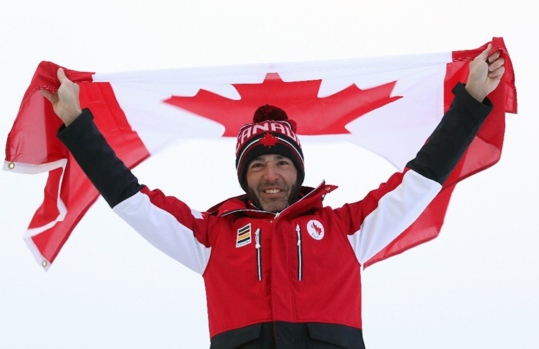 Brian McKeever waves the flag over his head