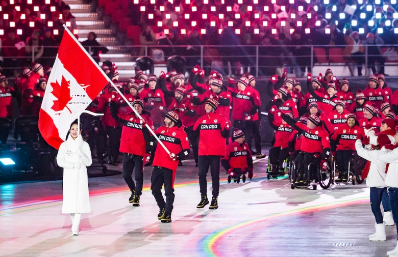 Brian McKeever carrying the Canadian flag in the opening ceremonies at the 2018 Paralympic Winter Games in PyeongChang