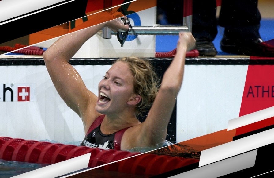 Para swimmer Danielle Campo celebrates after winning a race at the Athens 2004 Paralympic Games.