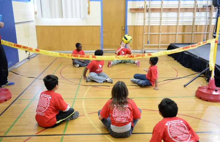 kids playing sitting volleyball